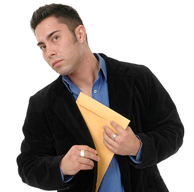 man slipping confidential files into his jacket